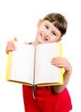Liten flicka med boken Arkivbild