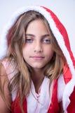 Liten flicka med en julblick royaltyfria bilder