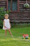 Liten flicka med en leksak royaltyfria bilder