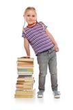 Liten flicka med en stapel av böcker Arkivbilder