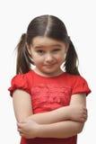 Liten flicka med ett tvivelaktigt uttryck arkivbild