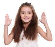 Liten flicka med härligt hår royaltyfri foto