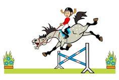 Liten flicka med ponnyn som hoppar en häck Arkivfoto