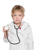 Liten flicka med stetoskopet Arkivfoton