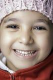Liten flicka med stort leende Arkivbild