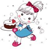 Liten flicka med tårtan Fotografering för Bildbyråer