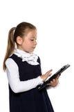 Liten flicka med tableten Royaltyfri Foto