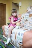 Liten flicka med toyen Arkivfoto