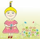 Liten flicka och blommor Arkivfoton