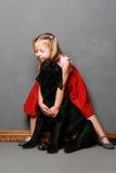 Liten flicka och hund i studion Fotografering för Bildbyråer
