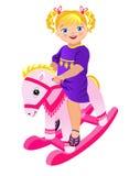 Liten flicka på att vagga hästen Royaltyfri Fotografi