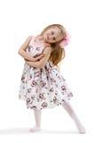 Liten flicka på en vit bakgrund Royaltyfria Bilder