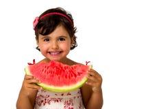 Liten flicka som äter vattenmelon Royaltyfria Foton