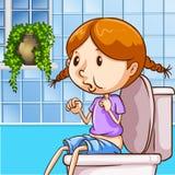 Liten flicka som använder toaletten Arkivfoton