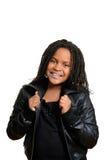 Liten flicka som bär det svarta läderomslaget Royaltyfria Bilder