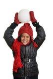 Liten flicka som går att kasta en kasta snöboll Fotografering för Bildbyråer