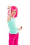 Liten flicka som kammar rosa hår Arkivbild