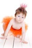Liten flicka som kläs som en prinsessagroda Royaltyfria Bilder