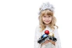 Liten flicka som kläs som snöflingor Royaltyfria Foton