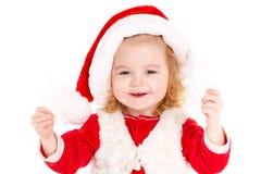 Liten flicka som kläs som Jultomte Arkivbild