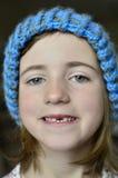 Liten flicka som ler missande Front Tooth Royaltyfri Bild
