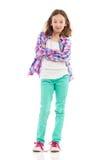 Liten flicka som poserar med korsade armar Fotografering för Bildbyråer