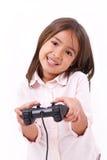 Liten flickagamer som spelar videospelet Arkivbild
