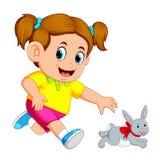 Liten flickalås upp en kanin stock illustrationer