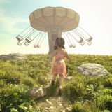 Liten flickaspring i ett fält Arkivbilder