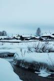 Liten flod för is i snö Royaltyfri Fotografi