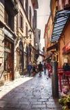 Liten gata i bolognaen, Italien, nära piazza Maggiore, 11 marsch 2 Fotografering för Bildbyråer