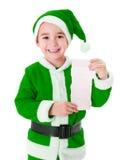 Liten grön önskelista för Santa Claus pojkevisning Fotografering för Bildbyråer