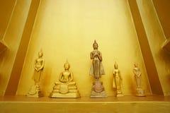 Liten guld- Buddha staty   Arkivfoton