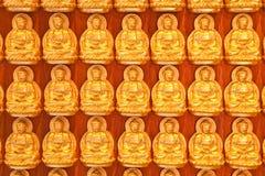 Liten guld- Buddhabakgrund Royaltyfri Bild
