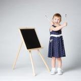 Liten gullig flickamålning Royaltyfria Foton