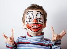 Liten gullig pojke med facepaint som clown Royaltyfria Foton