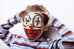 Liten gullig pojke med facepaint som clown Arkivfoto