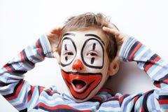Liten gullig pojke med facepaint som clown, Arkivbild