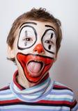 Liten gullig pojke med facepaint som clown Royaltyfri Fotografi