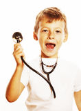 Liten gullig pojke med stetoskopet som spelar som vuxet yrke D Royaltyfria Foton