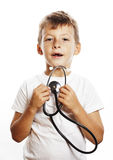 Liten gullig pojke med stetoskopet som spelar som vuxet yrke D Royaltyfri Fotografi
