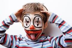 Liten gullig verklig pojke med facepaint som clown Fotografering för Bildbyråer