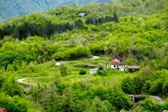 Liten by i berg Montenegro Royaltyfri Fotografi