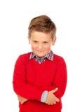 Liten ilsken unge med den röda ärmlös tröja royaltyfria foton