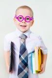 Liten intelligent pojke fotografering för bildbyråer