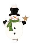 Liten klädnypa med en snögubbe, julmotiv, närbild Arkivfoto