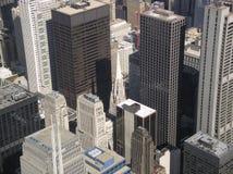 Liten kyrka mellan skyskrapor Royaltyfria Bilder
