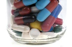 Liten medicinflaska av olika läkarbehandlingar arkivfoton