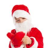Liten pojke som kläs som Santa Claus, isolering Royaltyfri Foto