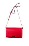 Liten röd handväska som isoleras på vit bakgrund Arkivbilder